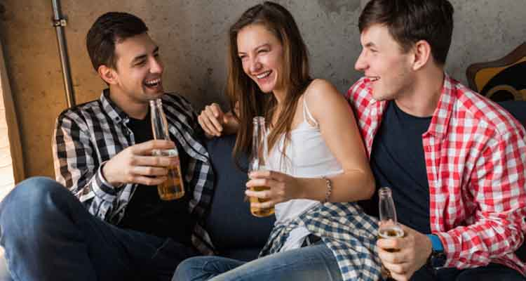 Woman with two man drinking