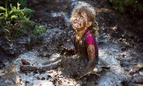 child in a mud