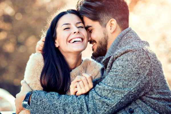 couple in deep love laughing together