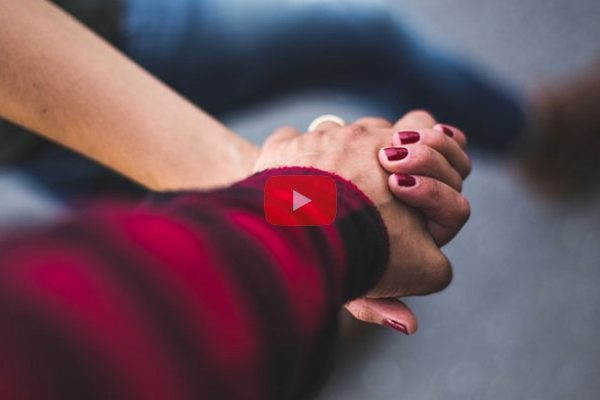 man-and-woman-holding hands