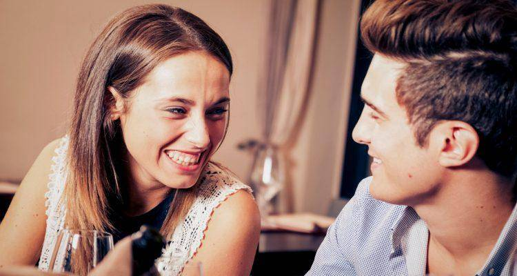man and woman laughing in restaurant