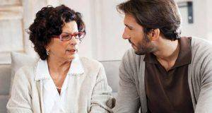 man talking with mother. You need to tell your parents about your divorce and prepare them in advance