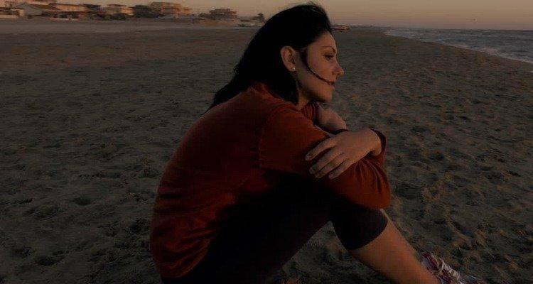 sad indian woman at the beach