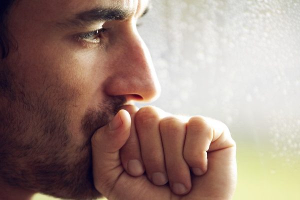 upset man seeing outside window