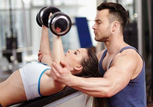 women and personal trainer