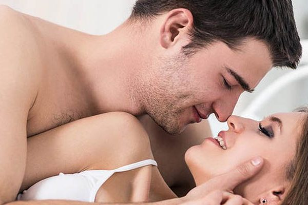 couple in bed try to kiss