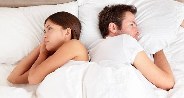 couple not talking in bed