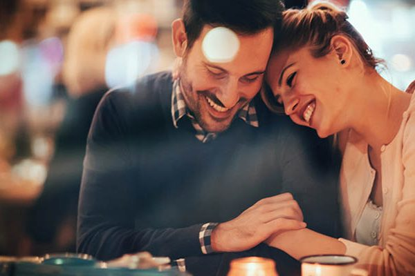 man and woman laughing in hotel
