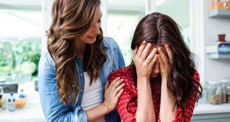 Woman consoling her friend
