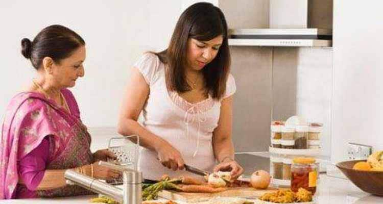 Daughter in law with mom in law in kitchen