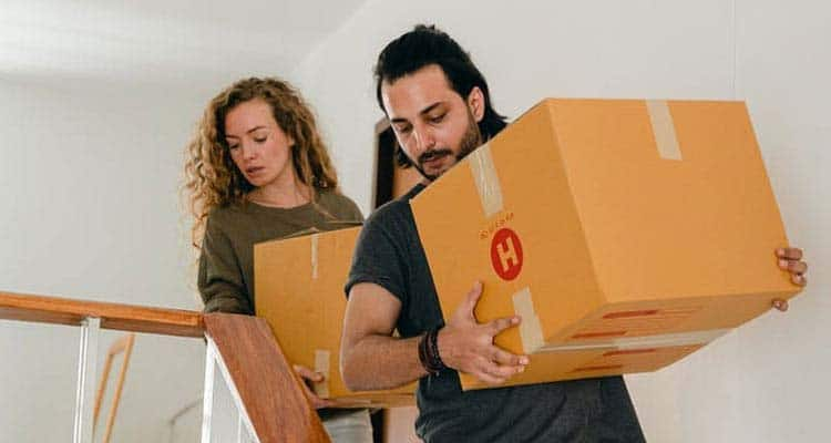 Couple moving out with pacakge