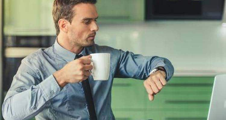Man checking watch in office