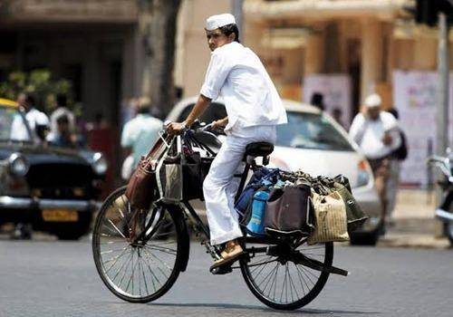 Dabbawalas use cycles in India to deliver food