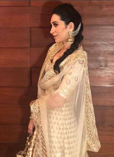 Karisma Kapoor in a heavily embroidered Manish Malhotra gold lehengha showed how to get the Big-Fat-Punjabi-wedding look right