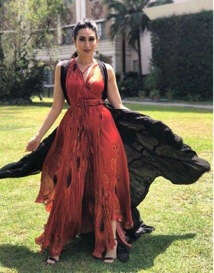 In a red Bohemian ensemble, with a black cape and a burn, Krishma Kapoor showed us how she slay just about everything