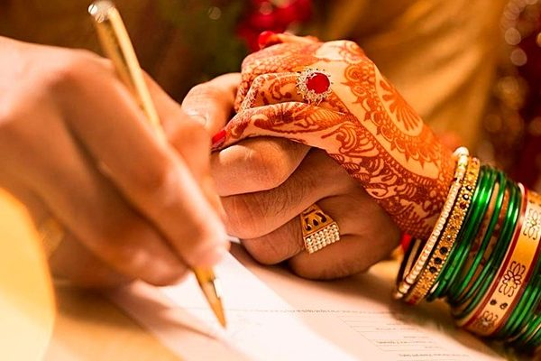 you can go for a court marriage in India or a Arya Samaj marriage