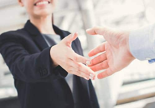 woman shaking hand