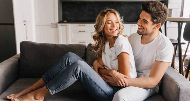 Couple sharing cozy moments on sofa