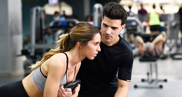 Young boy in gym with women