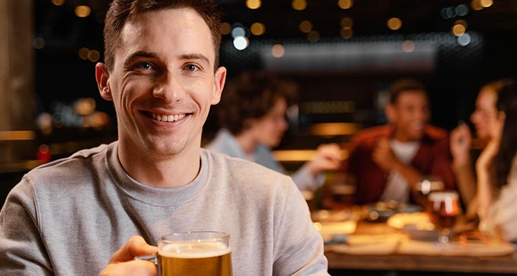 Man drinking beer in party
