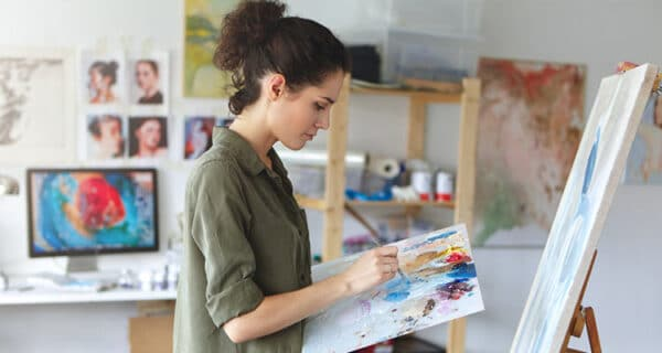 Girl painter her in art studio