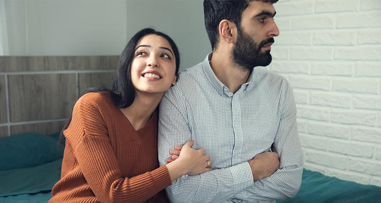 happy woman with angry man