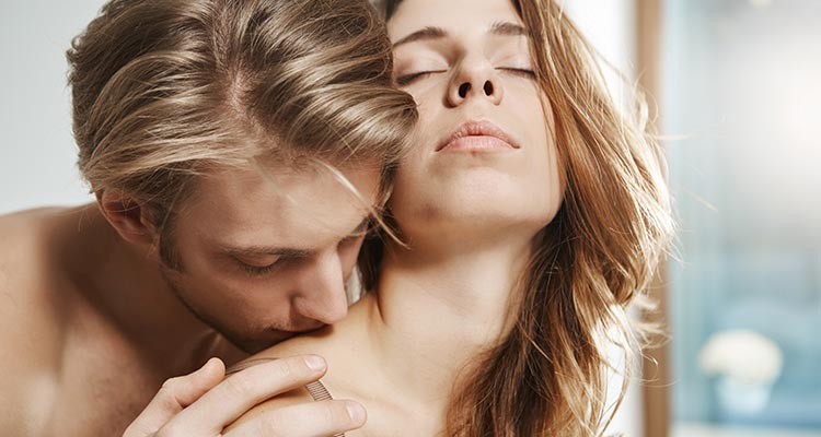 Passionate couple in bedroom