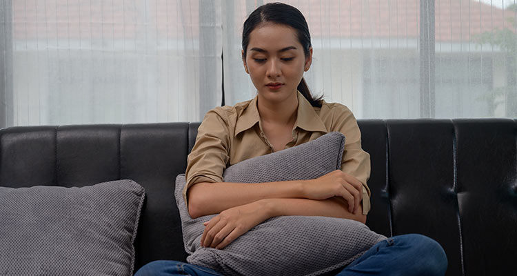 Depressed woman in home