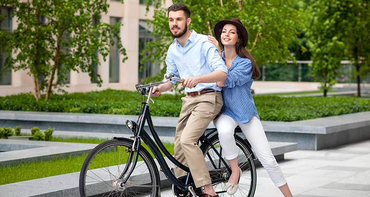 young couple sitting bicycle