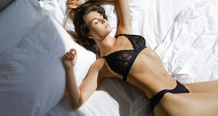 young sexy woman black lingerie lying bed imagination