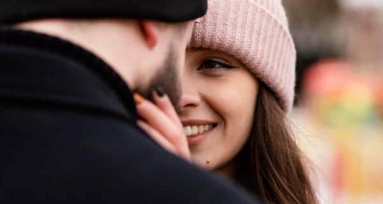 Woman smiling with man
