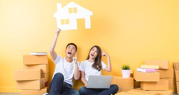 Couple searching house online