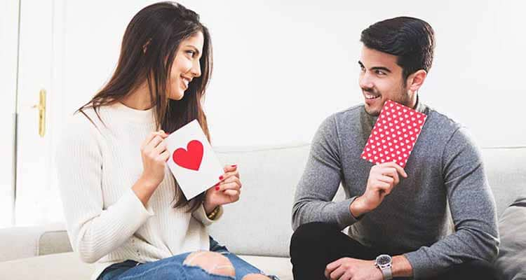 Couple showing card
