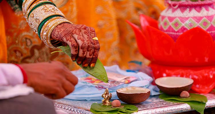 A couple doing havan or puja as per hindu tradition
