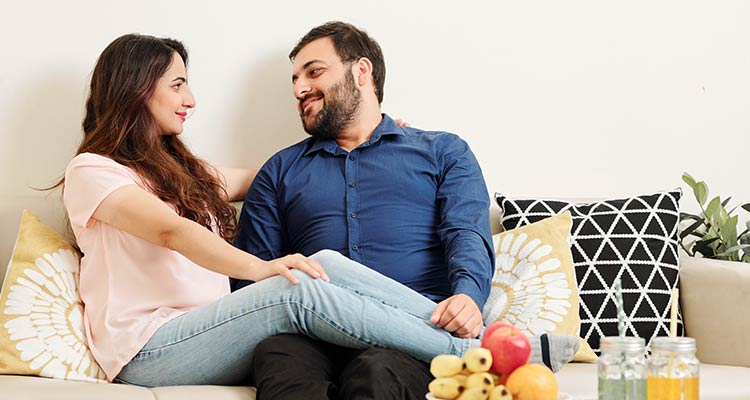 Couple in love resting on sofa
