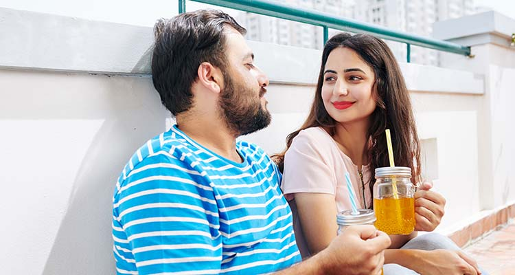 Couple resting on rooftop with mocktail