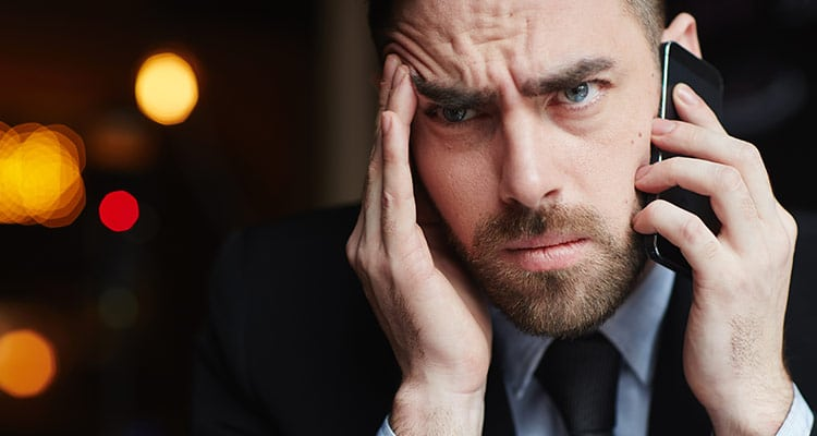 Frustrated man speaking on phone