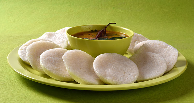 idli with sambar in bowl