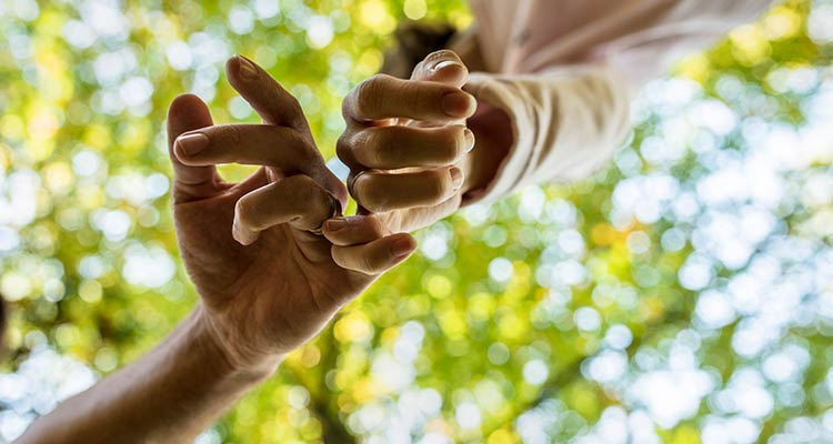 Man and woman walking along with linked fingers in a sign of affection and love