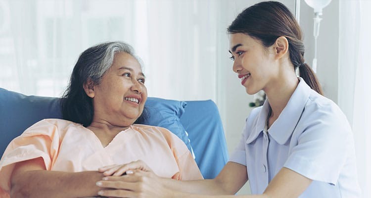 The nurses are well good taken care of elderly woman patients in hospital