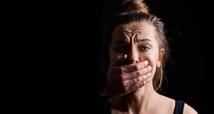 crying woman victim in fear suffering from female domestic violence
