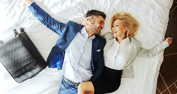 couple lying down on bed gonna have wonderful