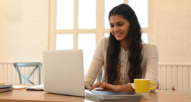Smiling pretty woman working in office