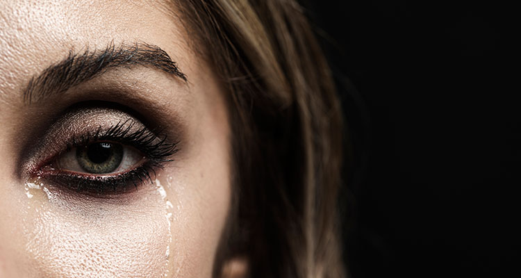 Woman with green eyes crying