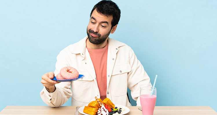 Unhappy man eating breakfast