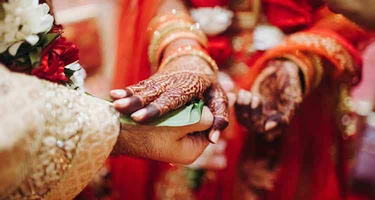 Indian couple hands during ritual of marriage